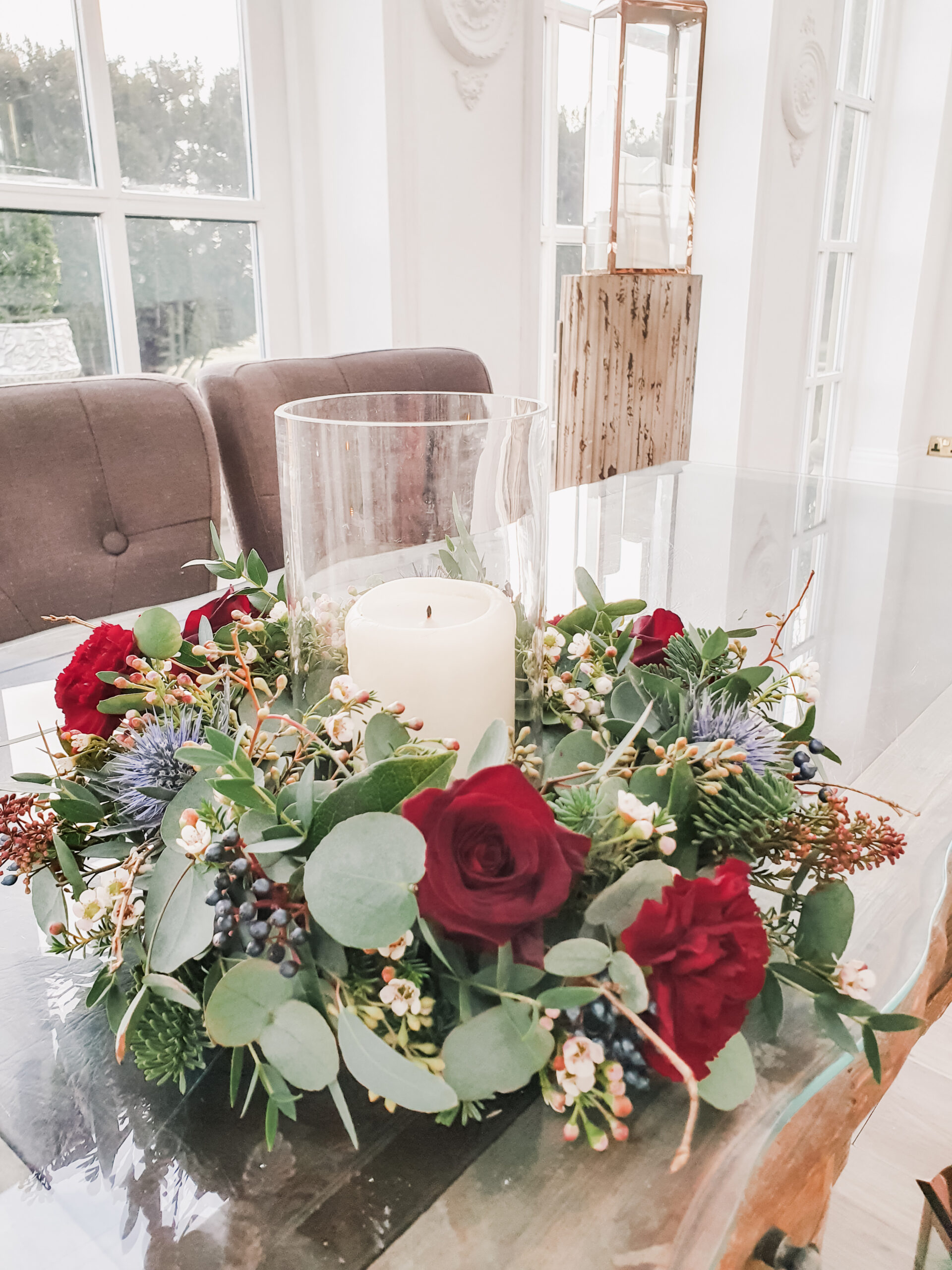 Wedding flowers on the registrars table in the Orangery at Woodhill Hall