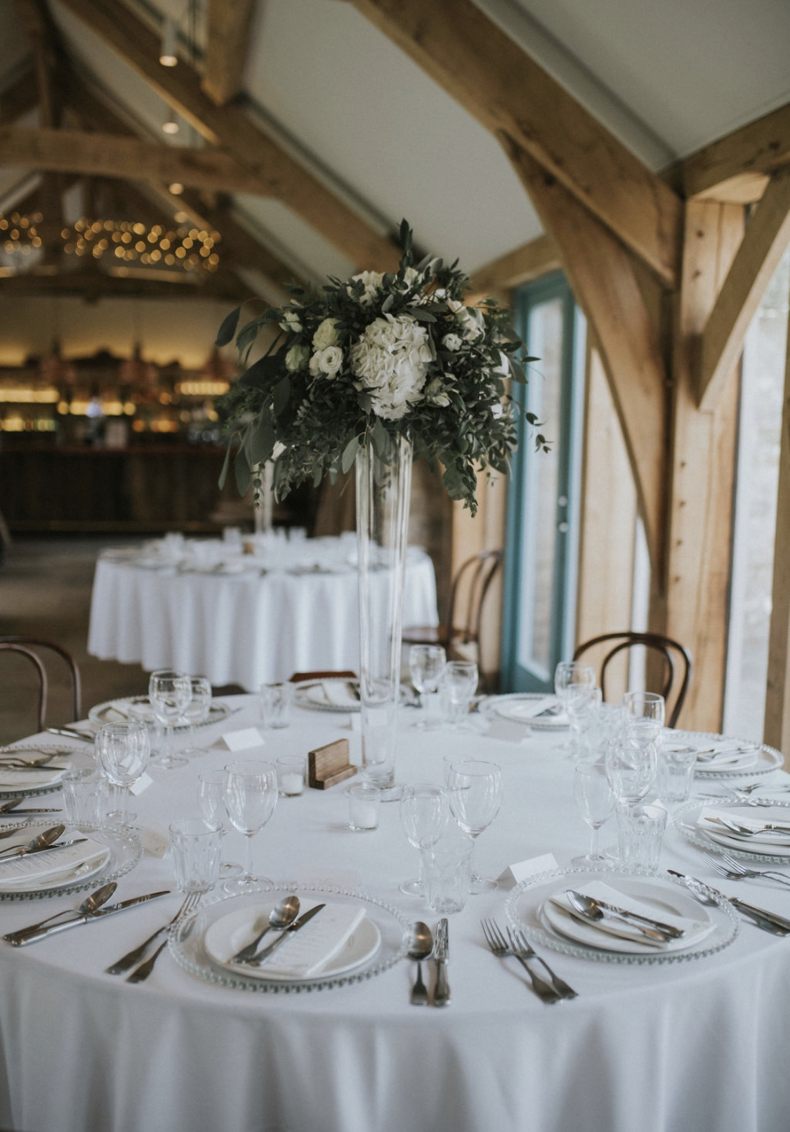 A floral wedding centrepiece at Healey Barn in Northumberland